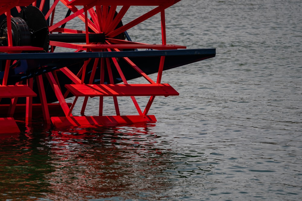 red wooden chair on water
