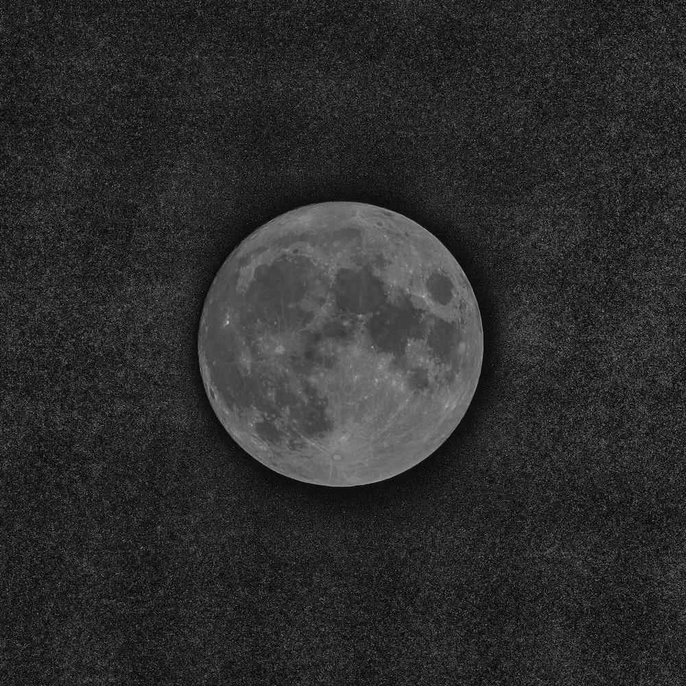full moon on black textile