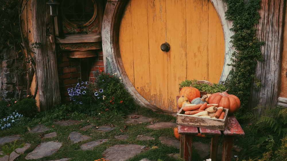 brown wooden table with pumpkins on top
