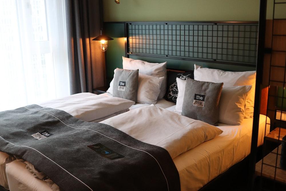 white throw pillows on white bed