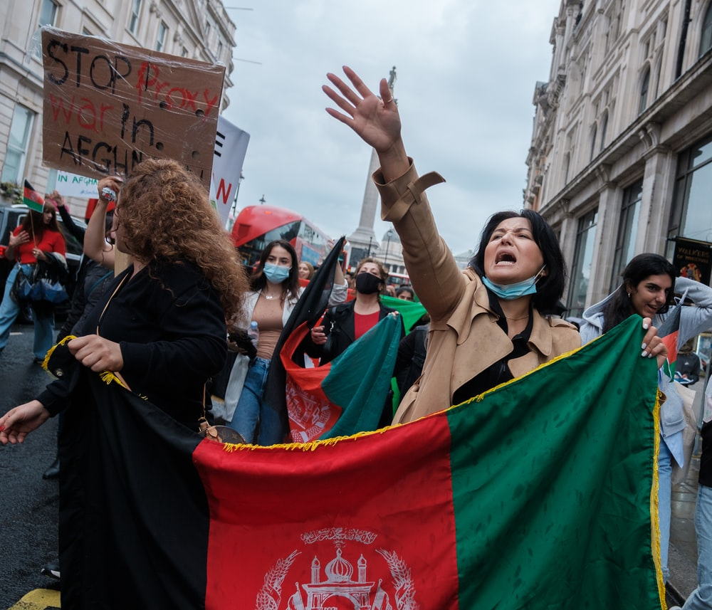 people holding flags during daytime