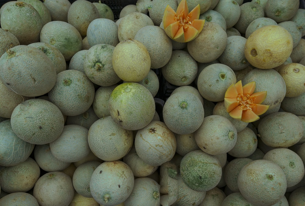 yellow round fruits on black plastic crate
