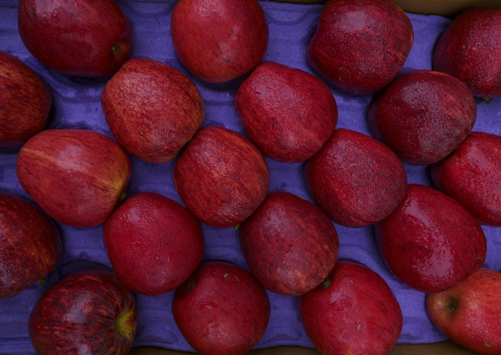red round fruits on white textile