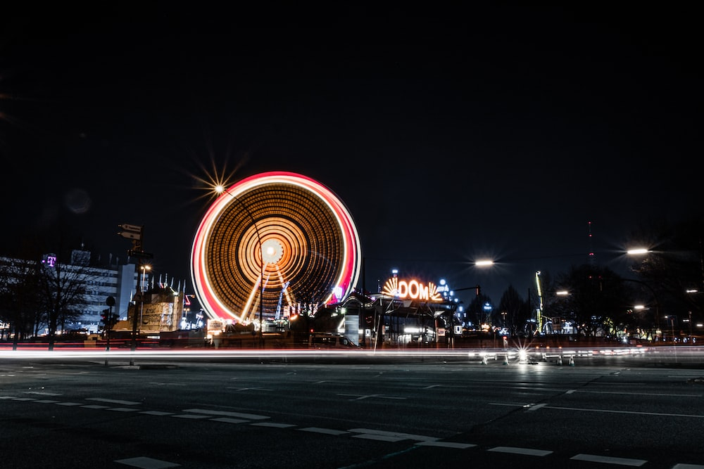 time lapse photography of ferris wheel during night time