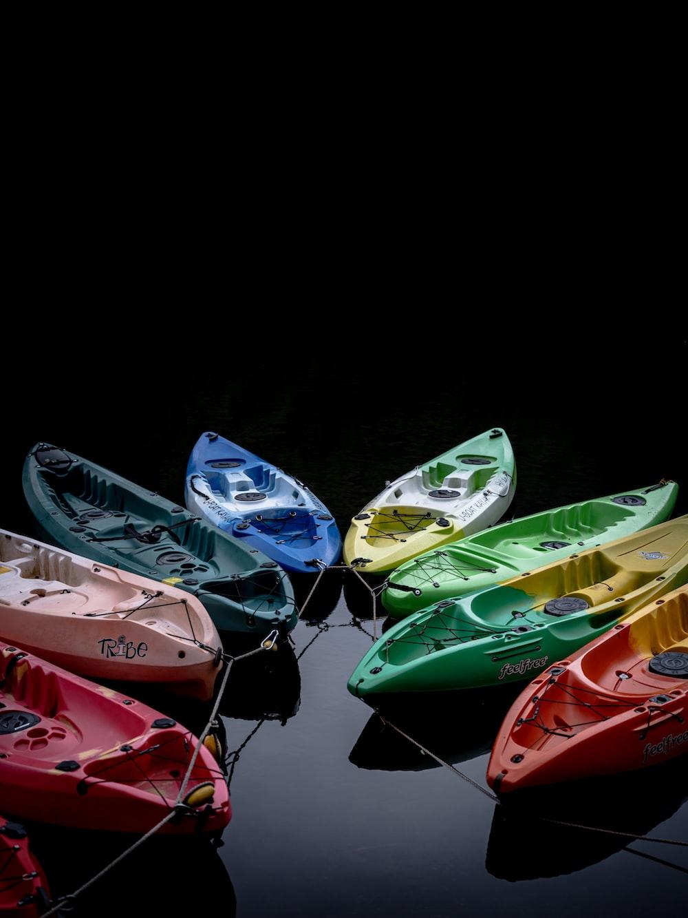 assorted color kayak on black surface