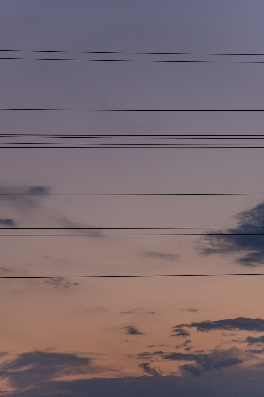 black electric wires under white clouds and blue sky during daytime