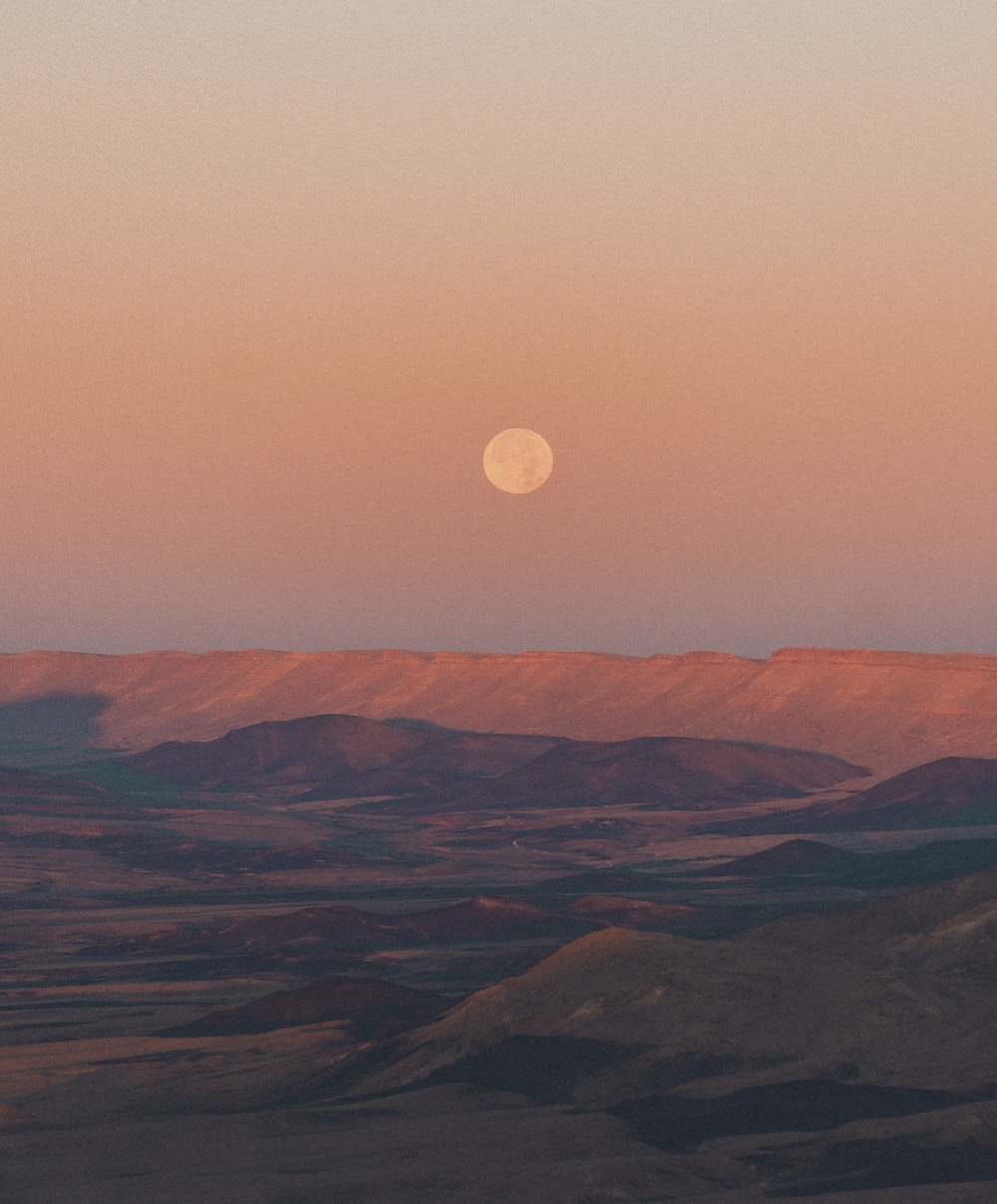 brown mountains under full moon