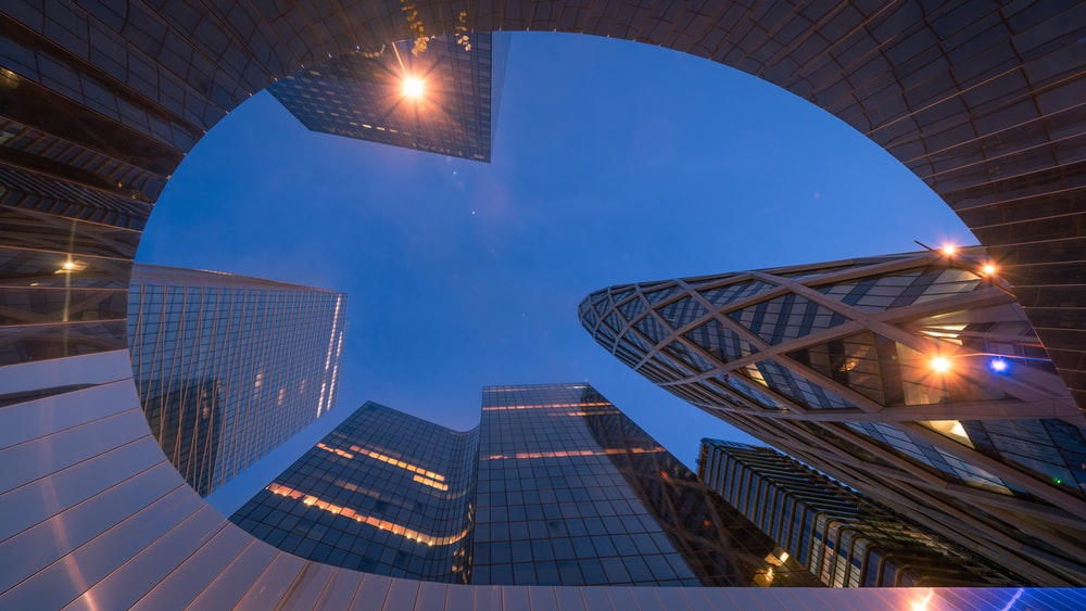 worms eye view of city buildings during night time