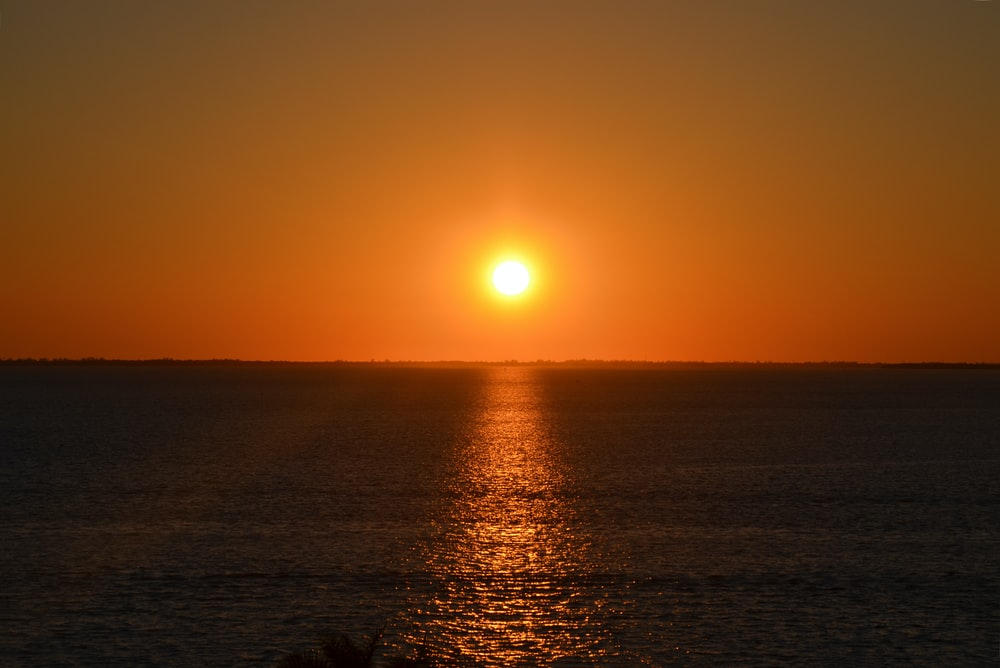 sunset over the sea with body of water