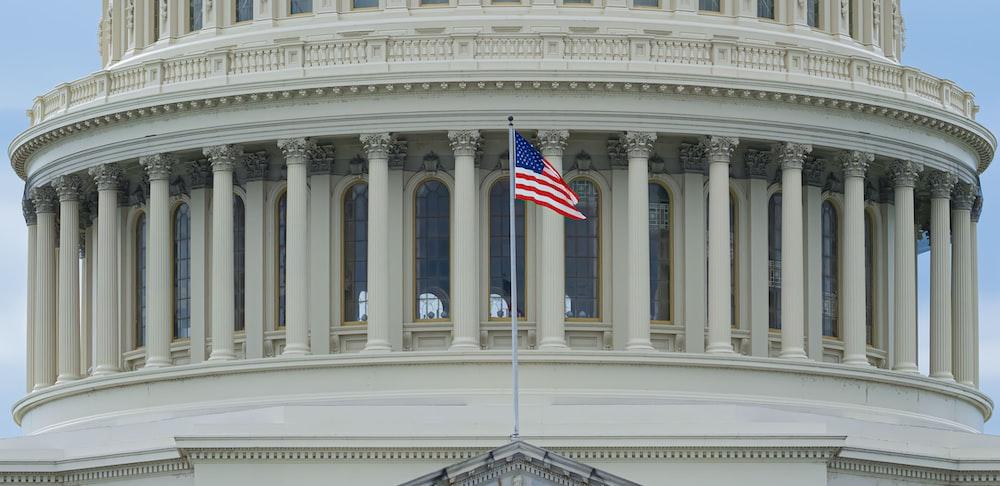 us a flag on white concrete building