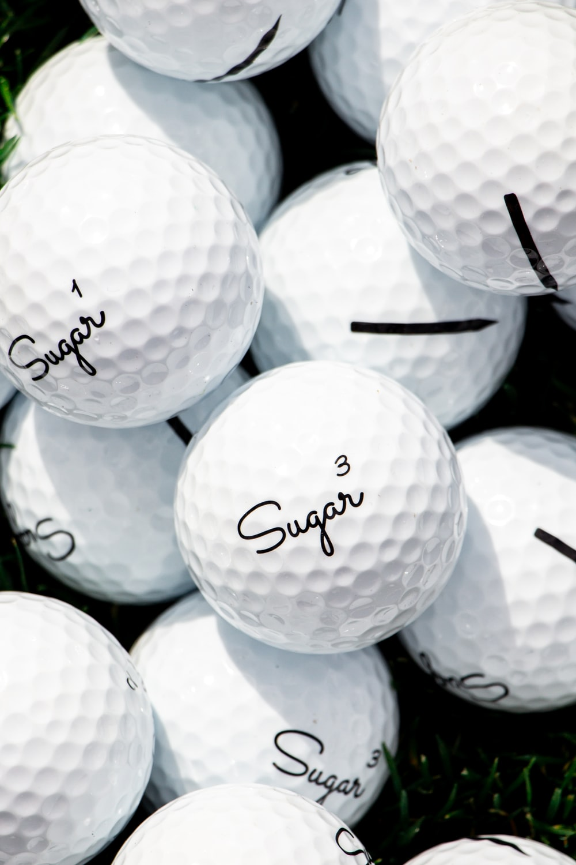 white golf ball lot on black background