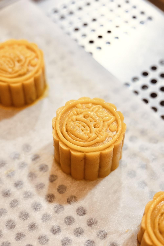 yellow cupcake on white textile