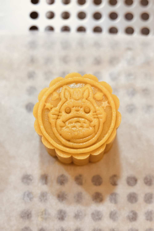 yellow cookie on white textile
