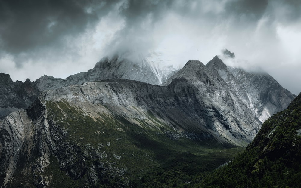 green and gray mountains under white clouds