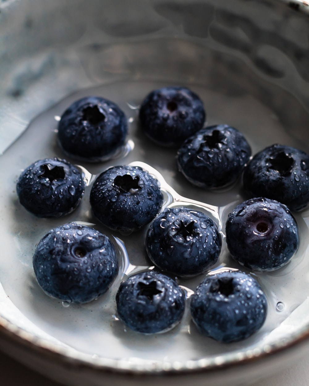 black berries on white ceramic plate