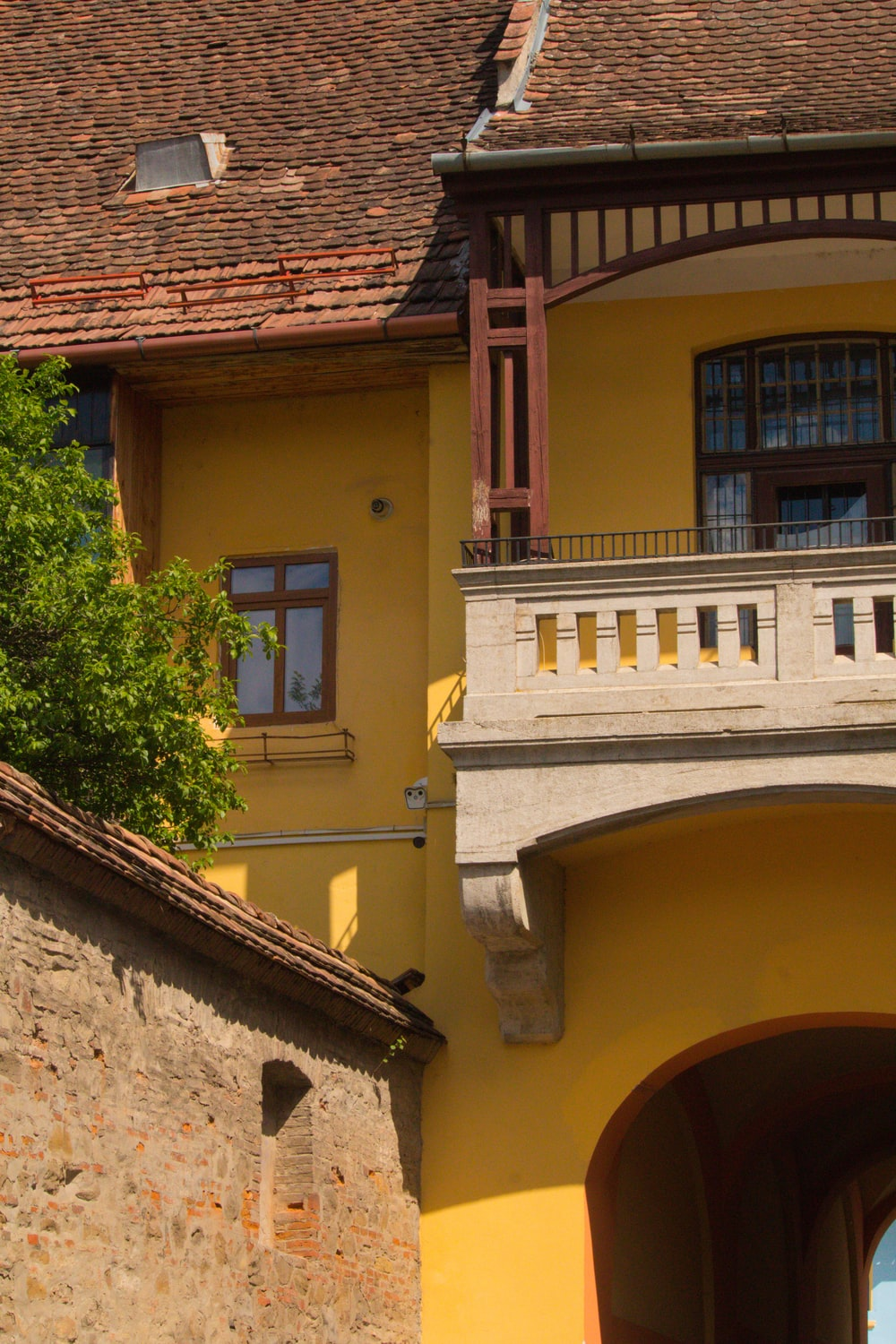 yellow and pink concrete house