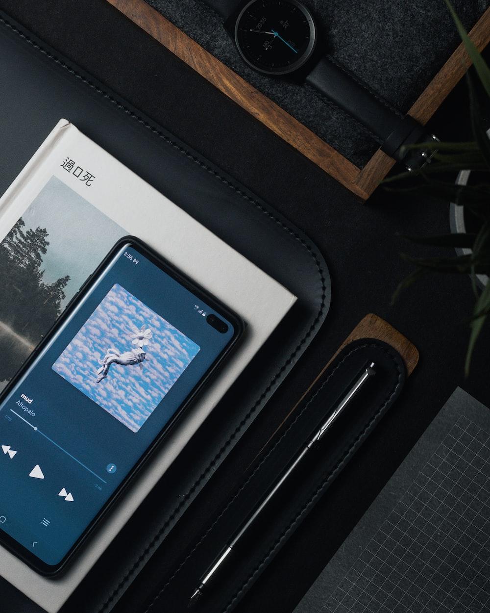 white ipad on black leather case