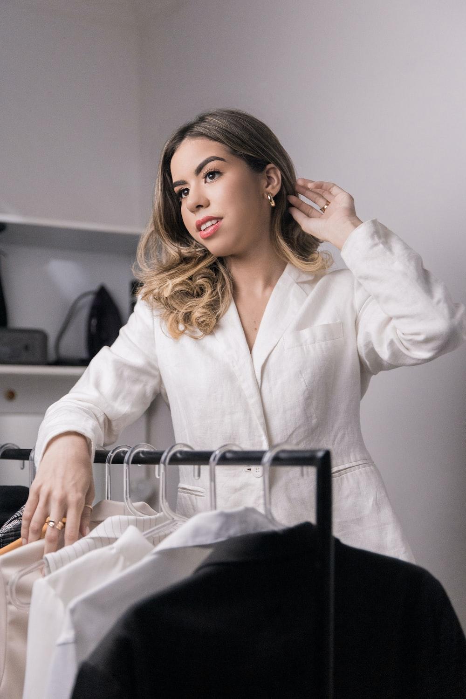 woman in white blazer sitting on chair