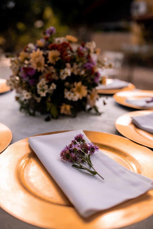 purple flowers on white ceramic plate