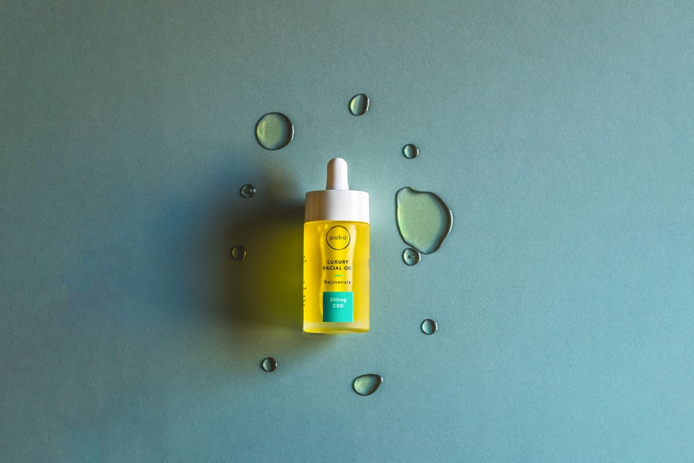yellow and white plastic bottle