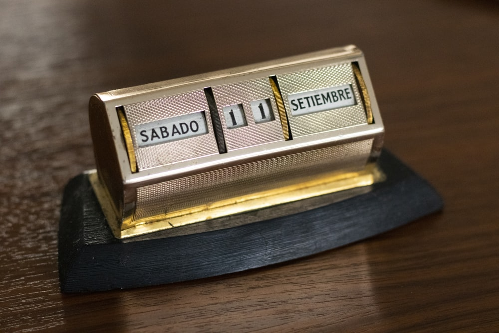 gold and silver box on brown wooden table