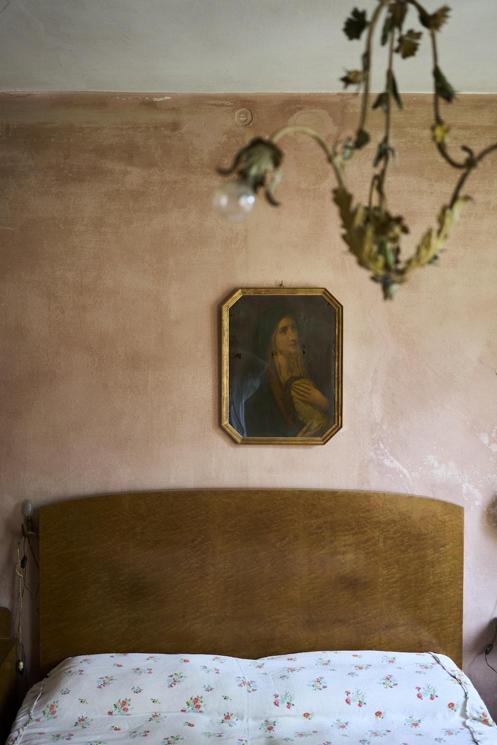 brown wooden framed painting of jesus christ