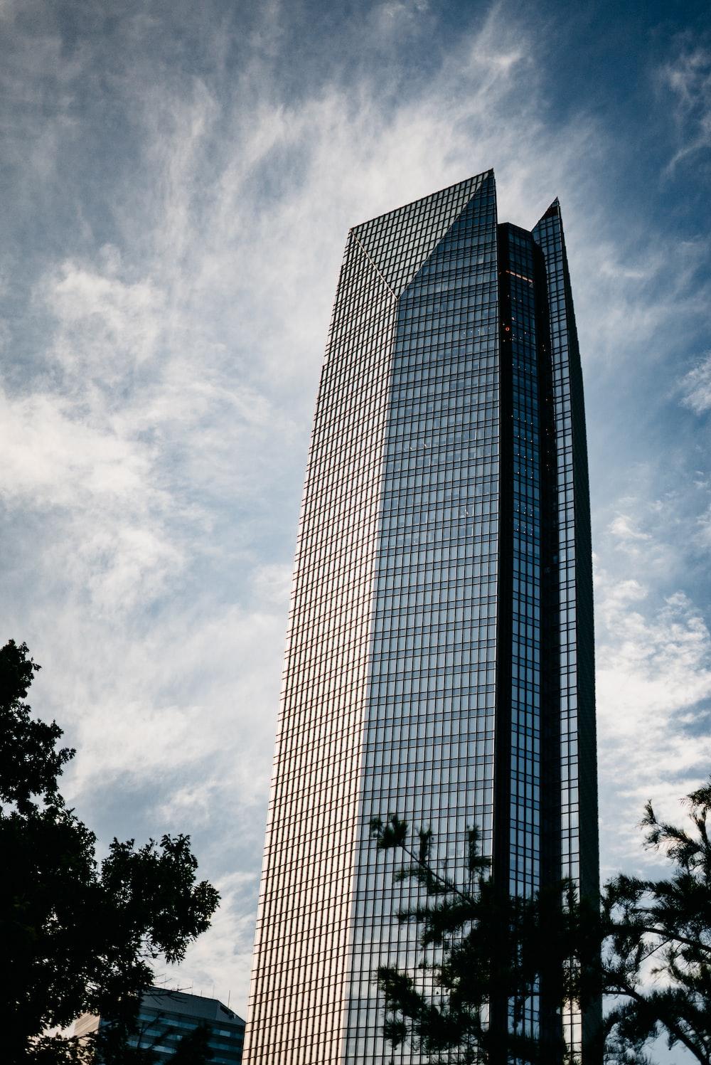 gray concrete building under gray clouds