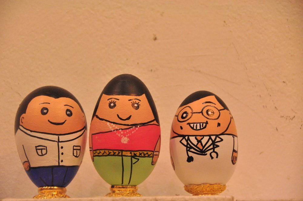 two brown and blue egg figurines