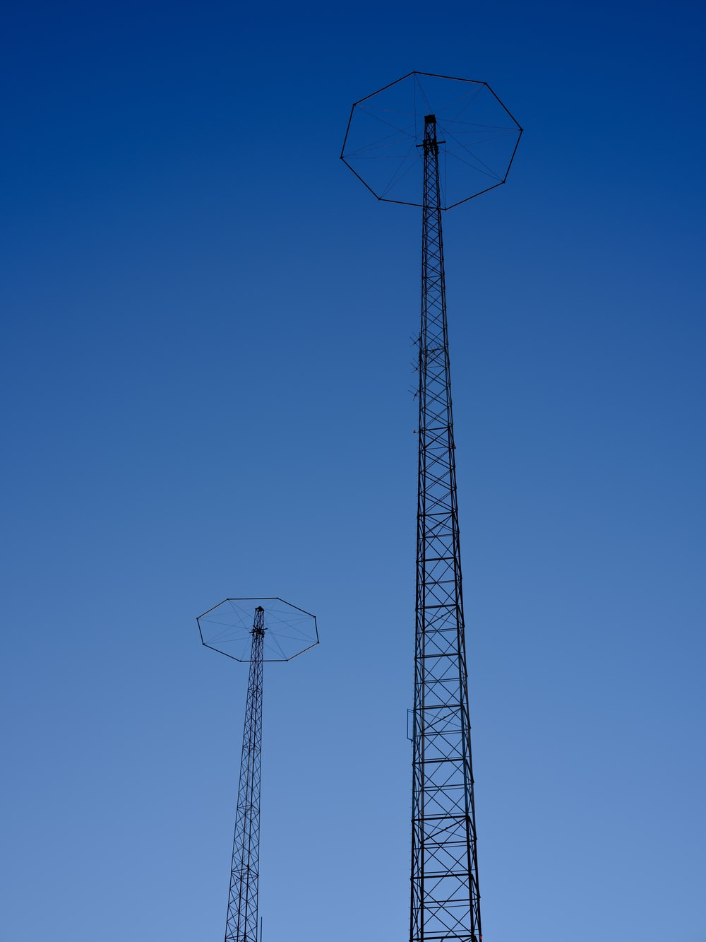 black steel electric post under blue sky during daytime
