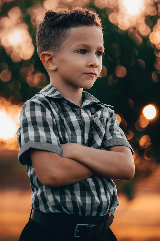 boy in black and white stripe polo shirt
