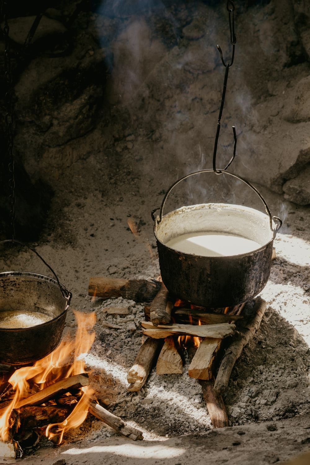 black cooking pot on fire