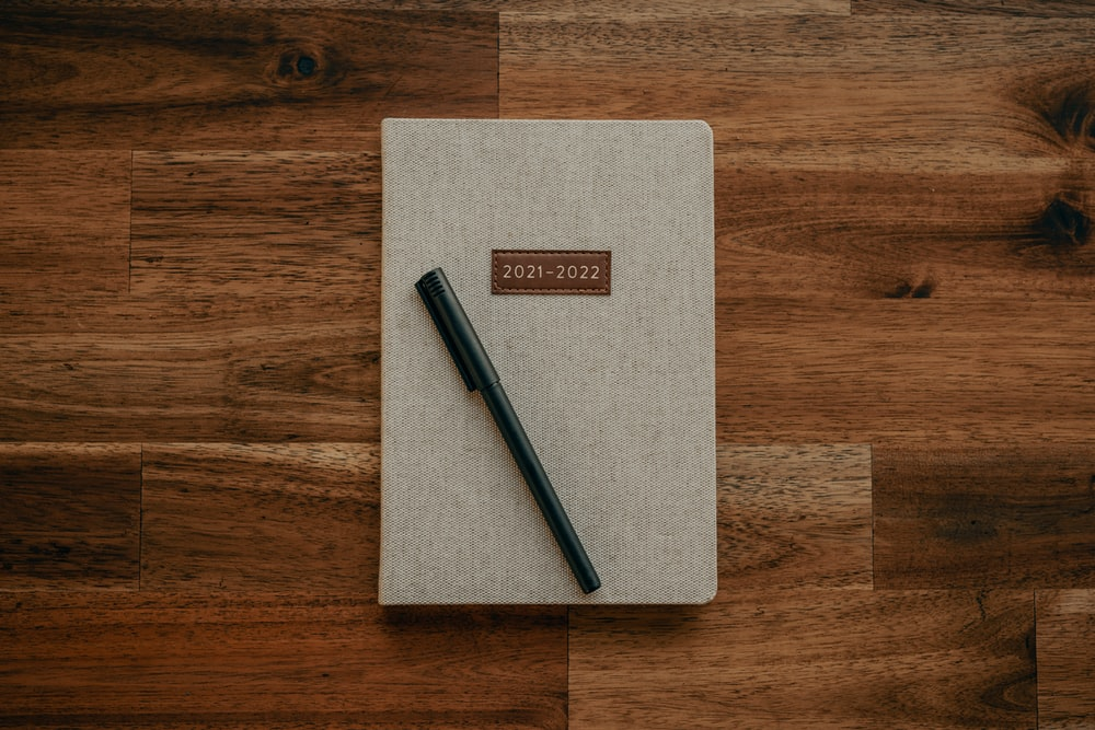 black pen on brown paper