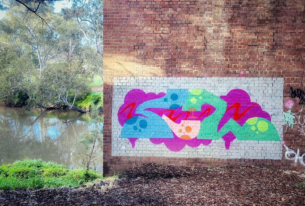 brown brick wall with graffiti