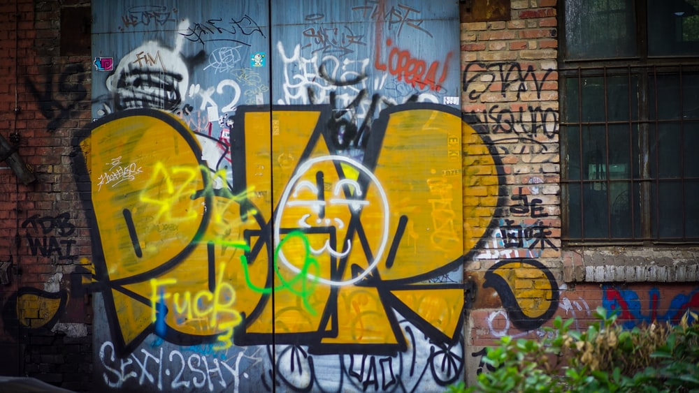 graffiti on brick wall during daytime