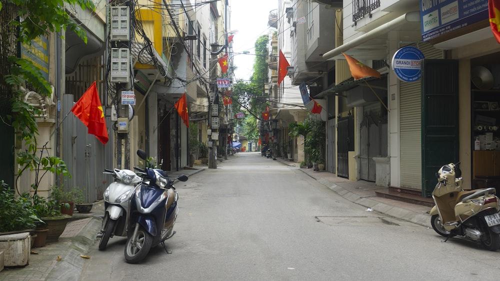 black motorcycle parked on sidewalk during daytime
