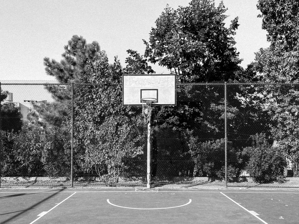 grayscale photo of basketball court