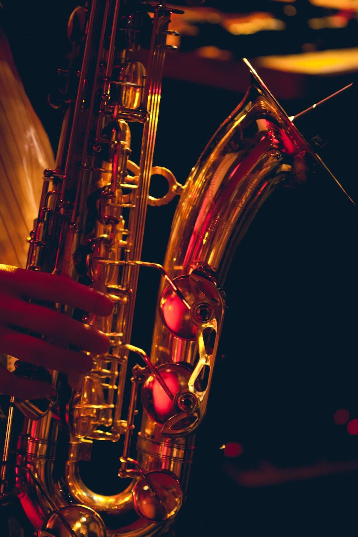 brass saxophone in black background