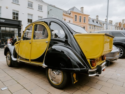 black and yellow vintage car on road during daytime