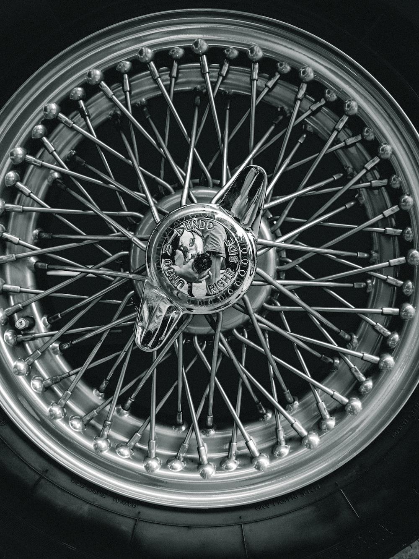 silver multi spoke wheel with tire