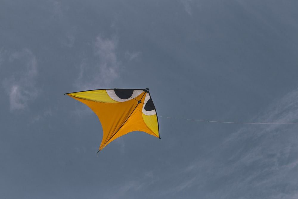 yellow and black umbrella under blue sky