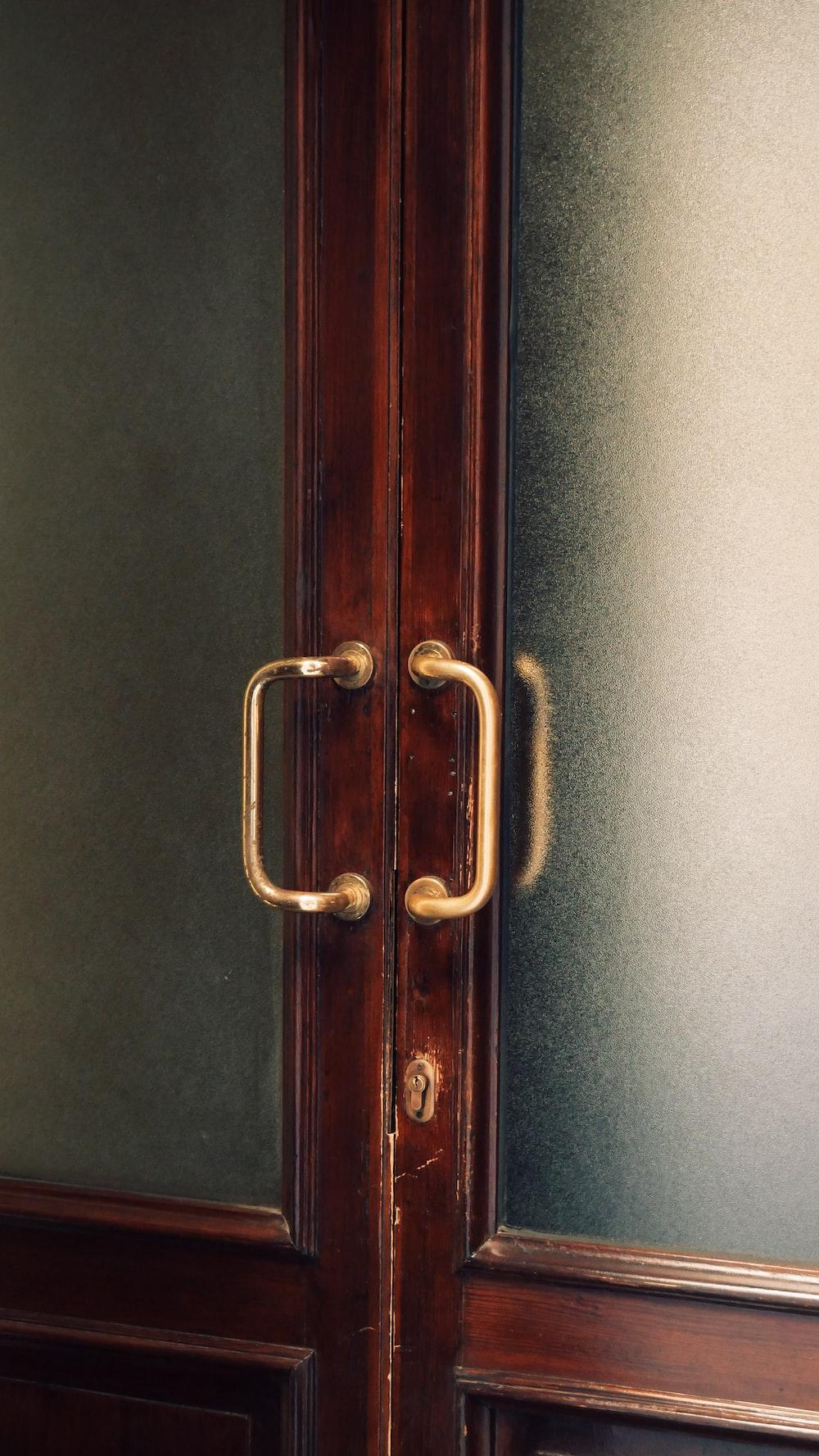 brown wooden door with silver handle