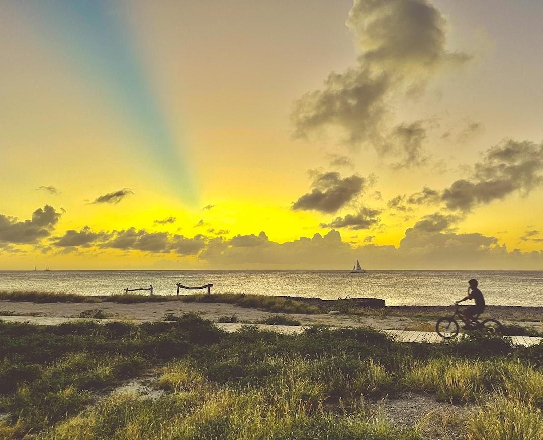 Sunset and blue sky stripes on Aruba island.