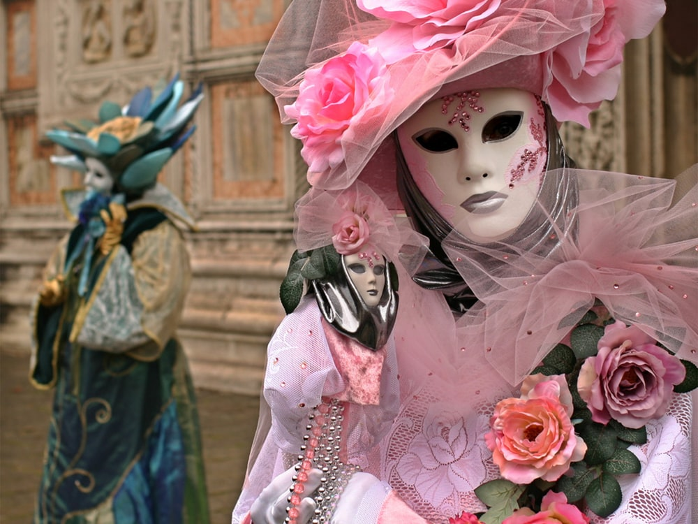 person wearing pink and white mask