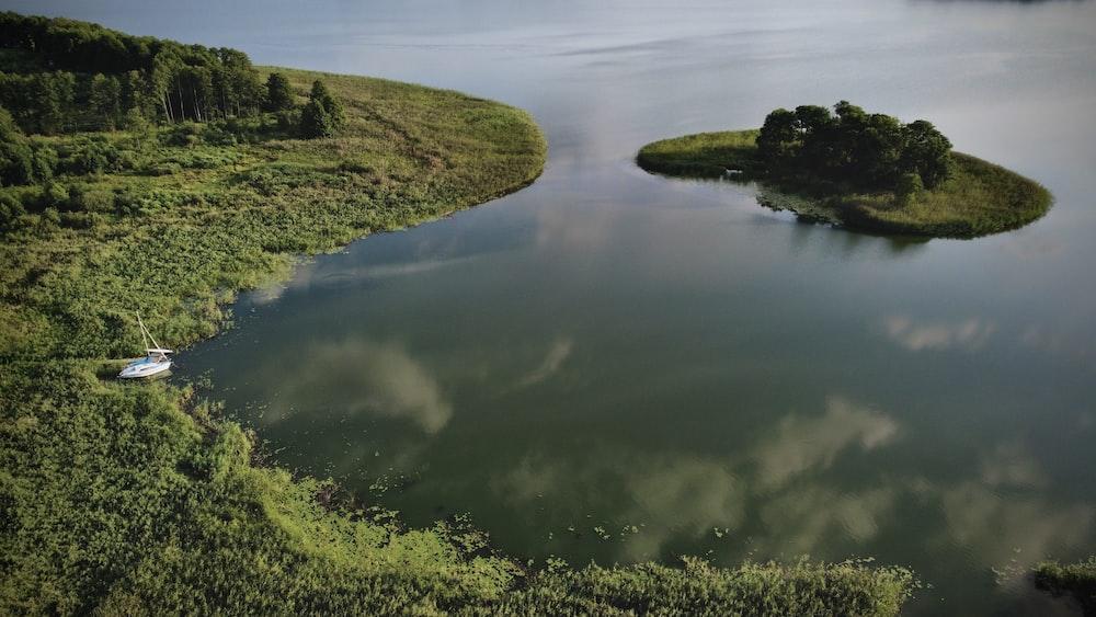 green grass field beside river during daytime