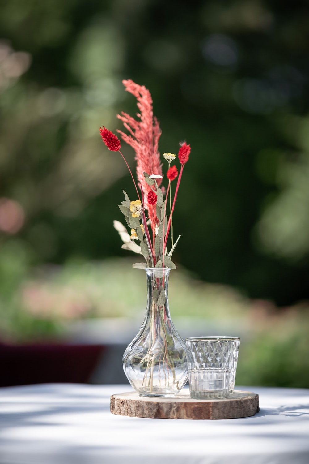 red flower in clear glass vase