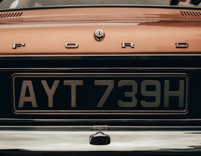 orange and black car plate