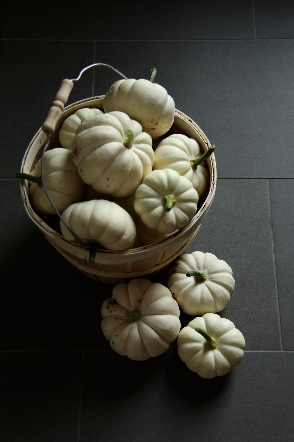 white garlic on brown wooden bucket