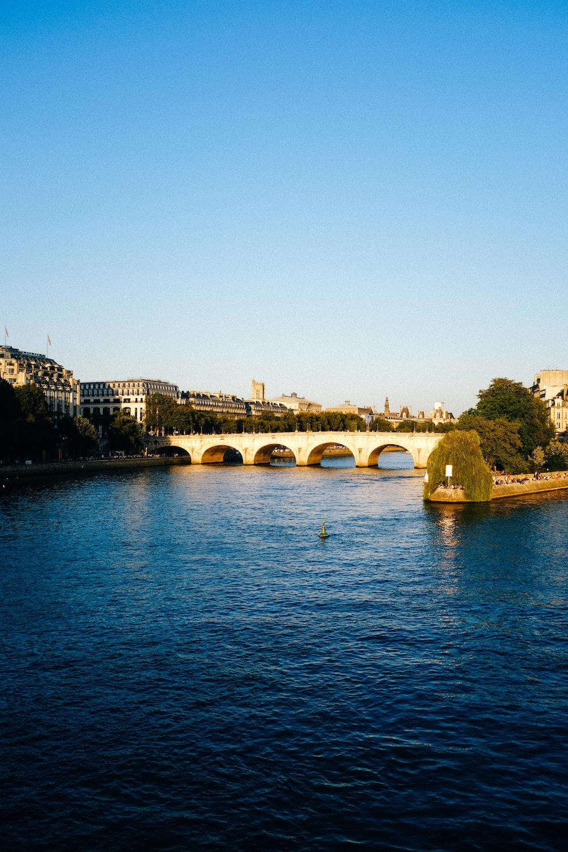 brown concrete bridge over blue sea during daytime