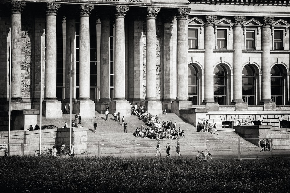 people walking on pathway near building during daytime