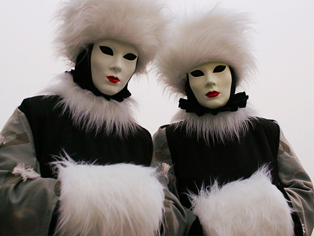 person wearing white and black clown costume